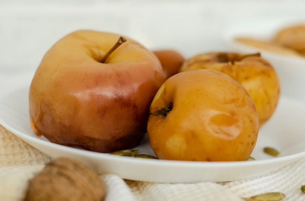 Baked apples on white. close up.