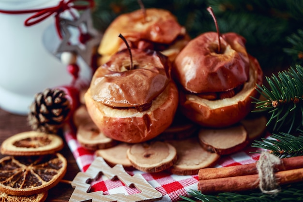 Baked apples with cinnamon on rustic background