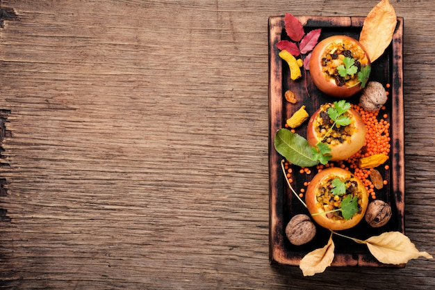 Baked autumn apples on wooden background