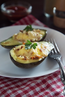 Baked avocado with cheese and bacon