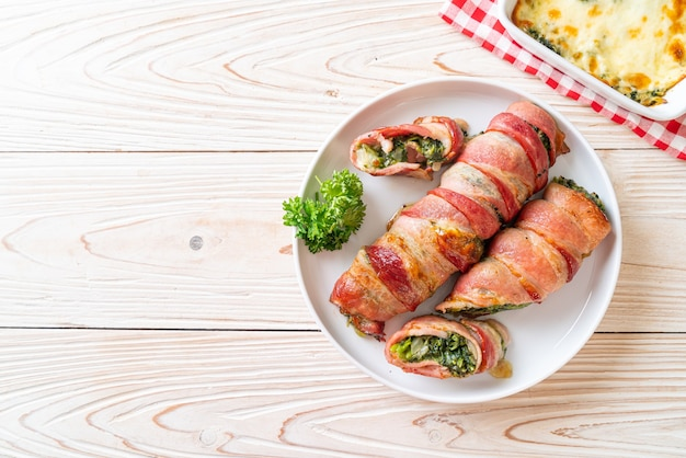 Baked bacon roll stuffed spinach and cheese
