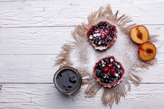 Baked baskets with berries, sweet cream and honey