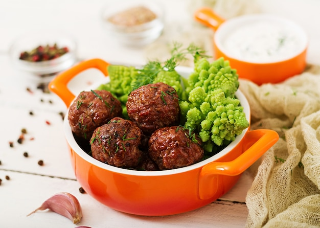 Baked beef meatballs and garnish from boiled cabbage romanesko. dietary menu. proper nutri