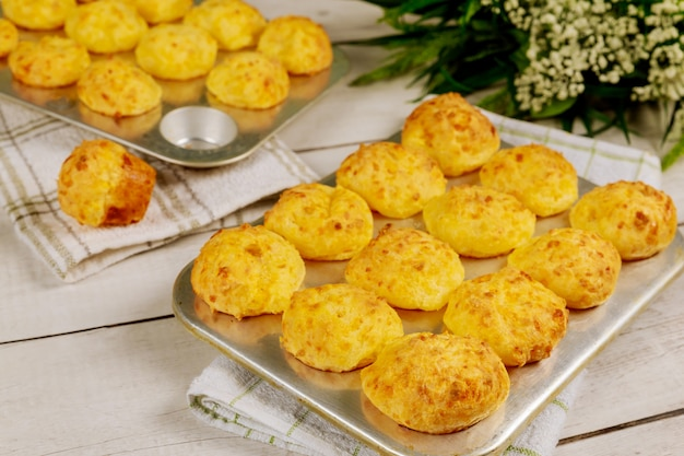 Baked brazilian cheese bread in baking pan with flowers