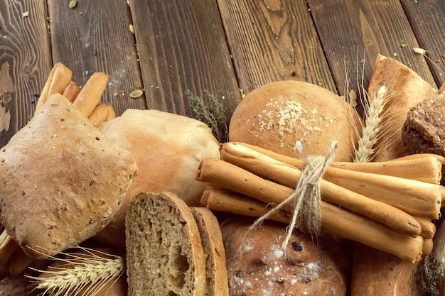 Baked bread on wooden table