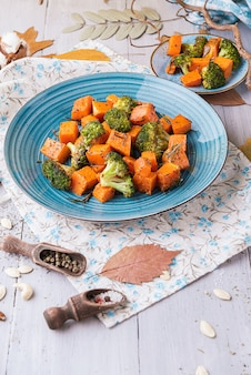 Baked broccoli and pumpkin. concept of healthy and delicious food.
