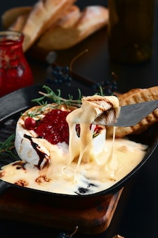 Baked camembert cheese with cranberry sauce