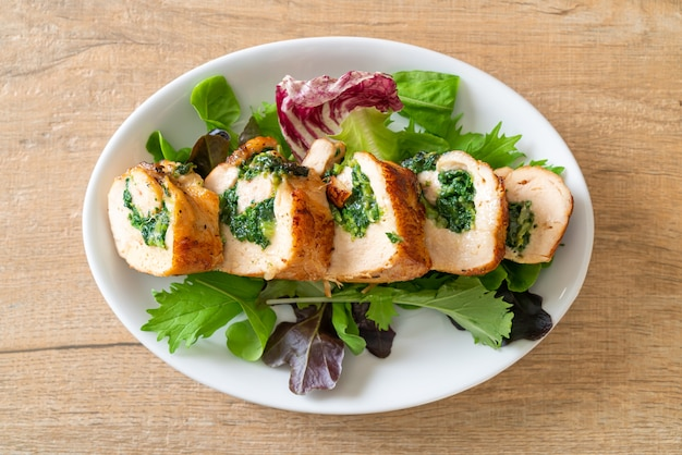 Baked chicken breast stuffed with cheese and spinach