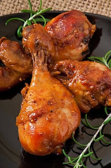 Baked chicken drumsticks in honey-mustard marinade