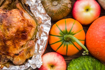 Baked chicken in foil with vegetables