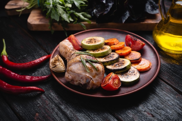 Baked chicken legs with vegetables