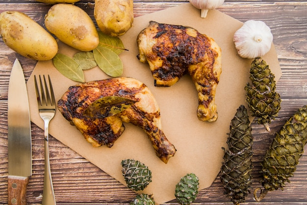 Baked chicken legs on wooden table