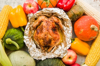Baked chicken on vegetables background