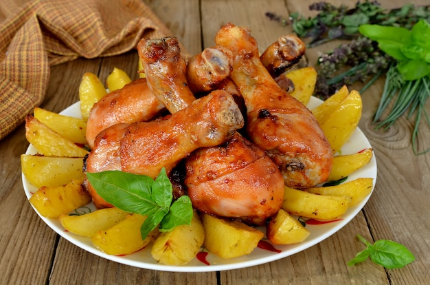 Baked chicken shins with a potato
