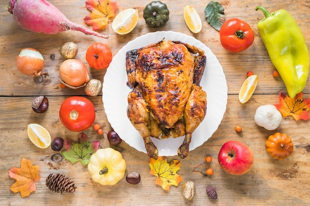 Baked chicken between vegetables and fruits