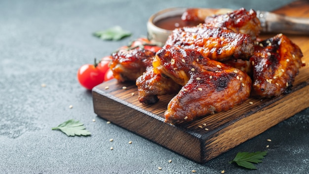 Baked chicken wings in barbecue sauce.