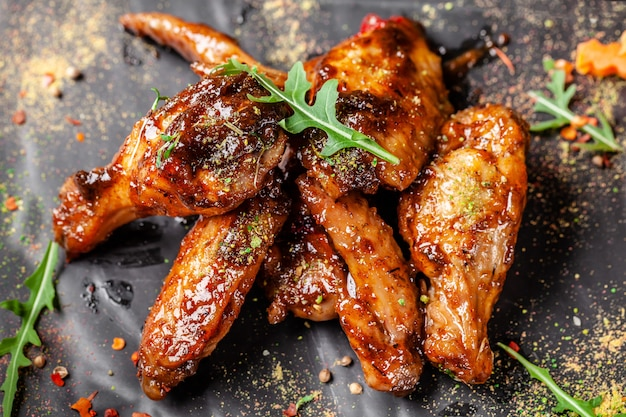 Baked chicken wings and legs in honey mustard sauce.