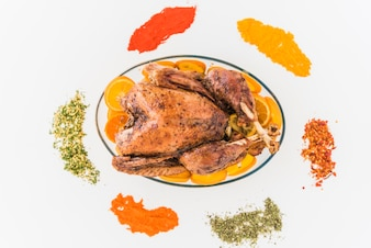 Baked chicken with flavourings on table