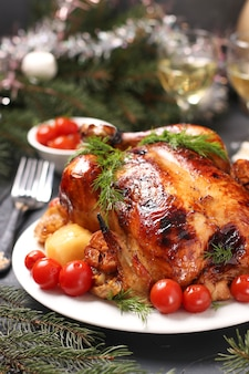Baked chicken with honey, soy sauce, onion and garlic, served with potatoes and cherry tomatoes