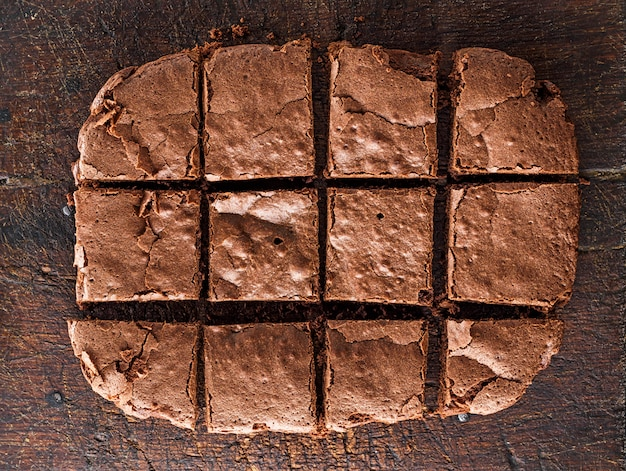 Baked  chocolate brownie pie is cut into squares