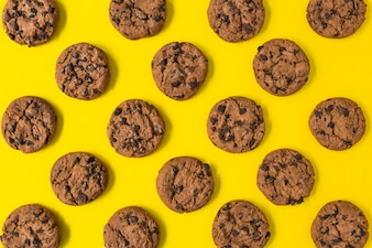 Baked chocolate cookies on yellow background
