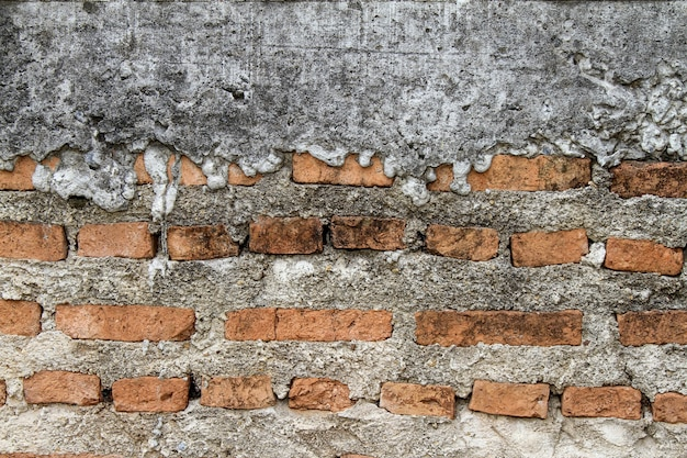 Baked clay of red brick in cement for wall