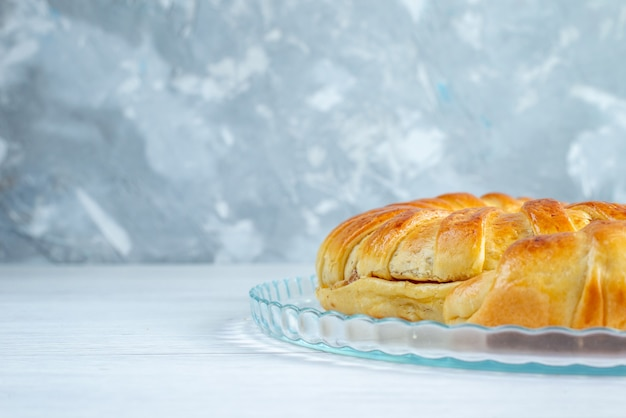 Baked delicious pastry bangle formed inside plate on light, pastry biscuit sweet bake