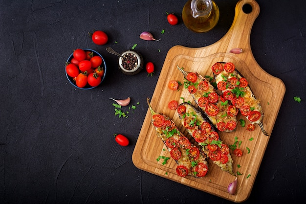 Baked eggplants with mozzarella and tomatoes with italian herbs.