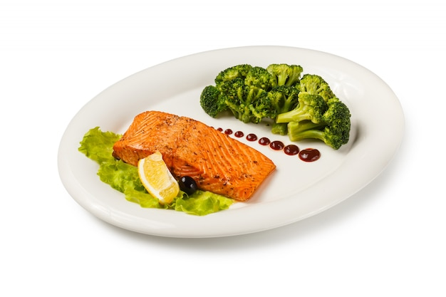 Baked fish salmon garnished with broccoli