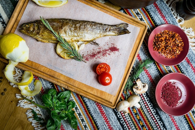 Baked fish seabass with fish spices and salad. seafood in restaurant