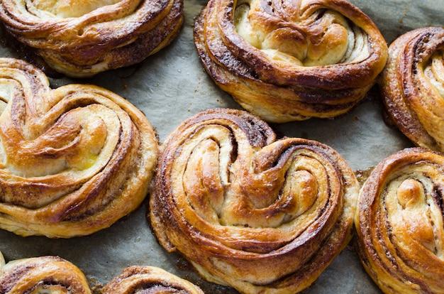 Baked fresh fragrant cinnamon buns. traditional homemade pastries.