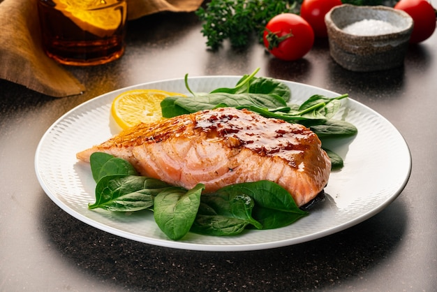 Baked or fried salmon and salad paleo keto fodmap dash diet mediterranean food with steamed fish