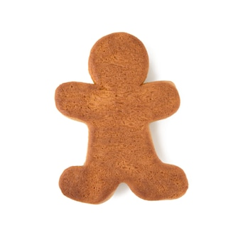 Baked gingerbread man shaped isolated on white background, top view
