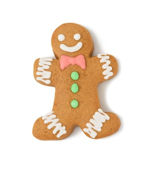 Baked gingerbread man shaped with smile isolated on white background, top view