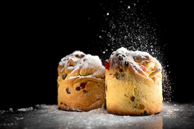 Baked goods sprinkled with powder similar to muffins