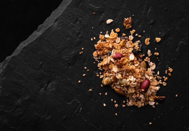 Baked grains with panela on carbonic black stone