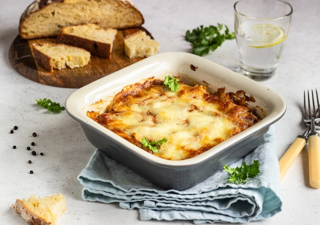 Baked gratin with chicken, vegetables in a tomato sauce with cheese.