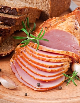 Baked ham with rosemary and rye bread