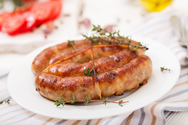 Baked homemade sausage on a white plate. thanksgiving day.
