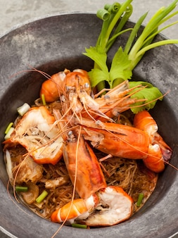 Baked king prawn vermicelli with soya sauce in hot pot.