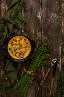 Baked lauren quiche with bacon and young bracken shoots