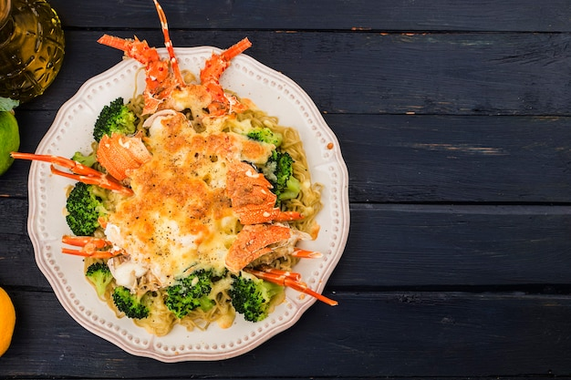 Baked lobster thermidor with cheese and vegetables