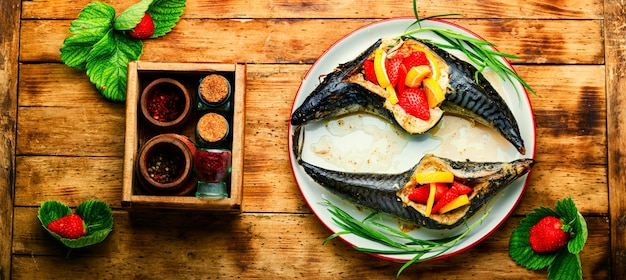 Baked mackerel or scomber with strawberries
