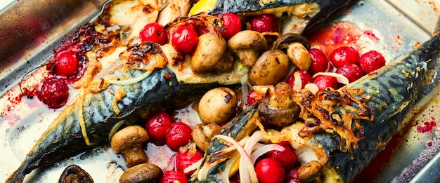 Baked mackerel with cherry sauce.fish filled with berries in baking dish