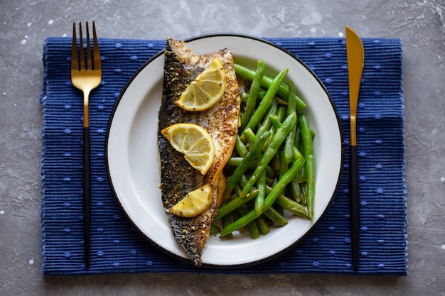 Baked mackerel with lemon and asparagus. asparagus bean with fish. delicious wholesome food. proper nutrition. fish in the oven. fried mackerel. delicious right dinner. view from above