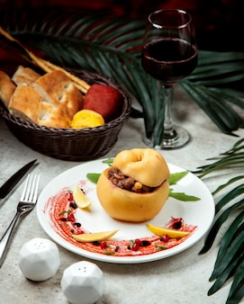 Baked meal in quince with bread