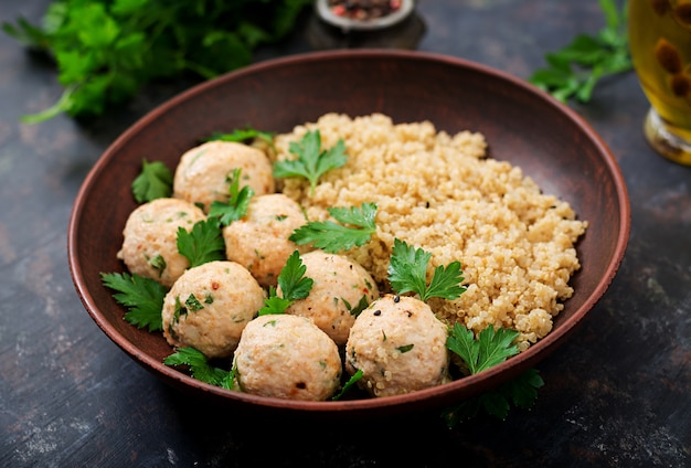 Baked meatballs of chicken fillet with garnished with quinoa. flat lay. top view.