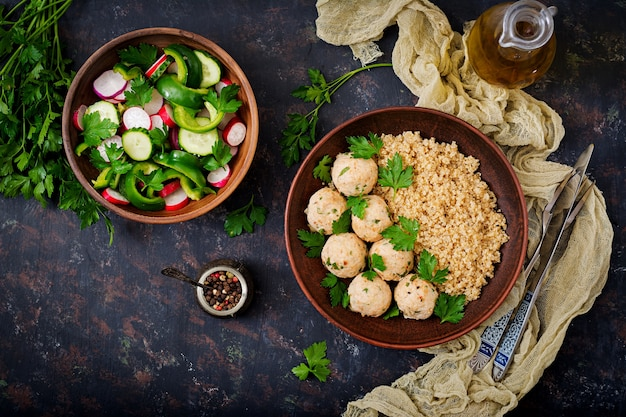 Baked meatballs of chicken fillet with garnished with quinoa.