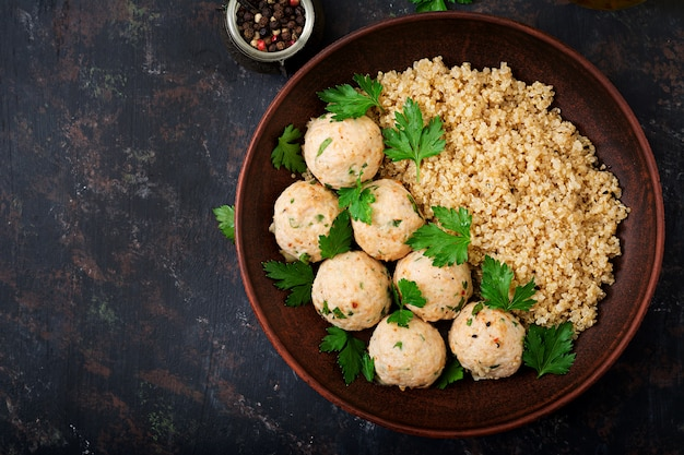 Baked meatballs of chicken fillet with garnished with quinoa