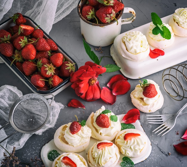 Baked meringue with cream and fresh strawberries